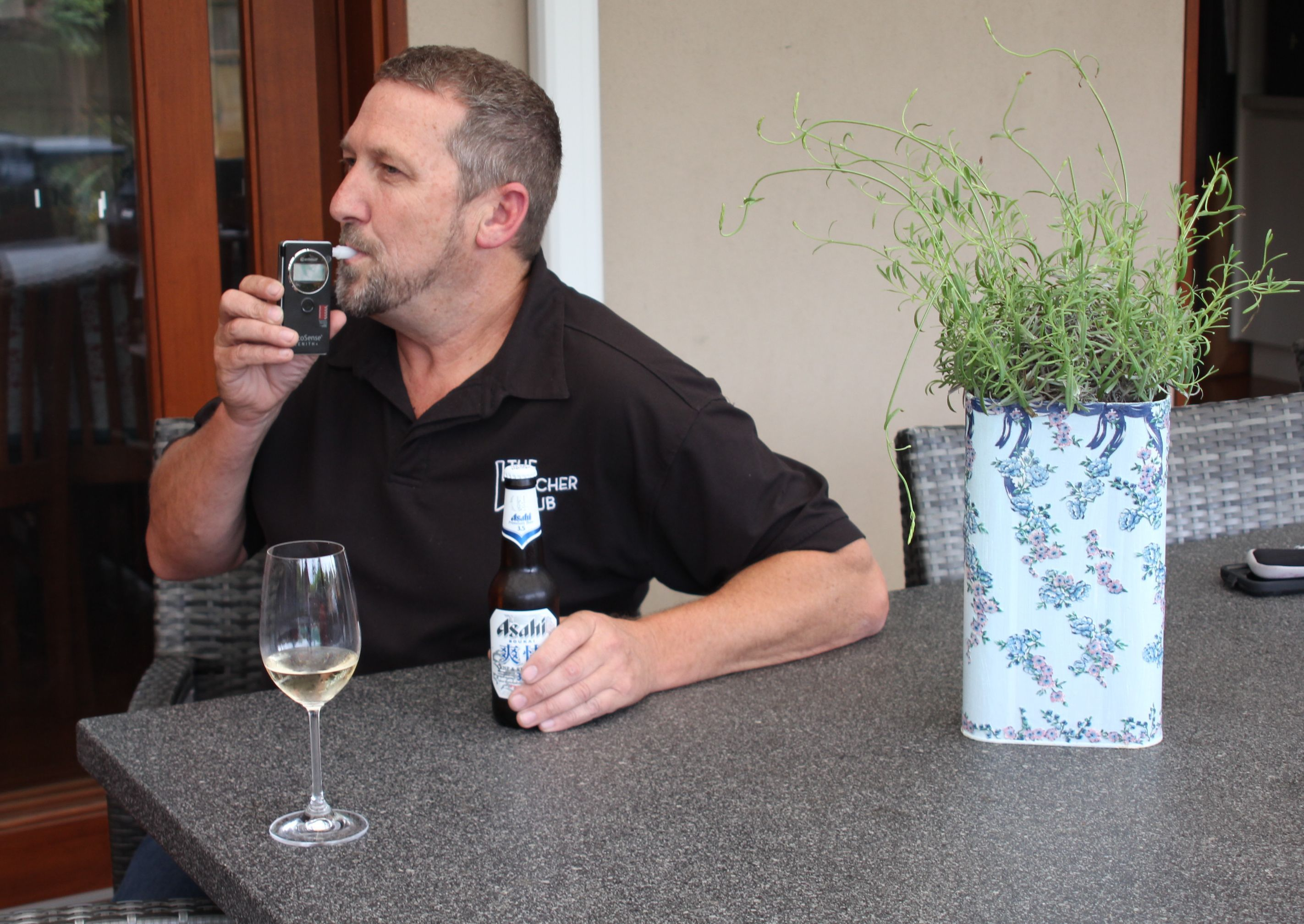 Peter Robinson tests his blood alcohol level (BAC) before deciding if he should have another beer using one of his personal breathalysers.
